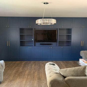 Media wall Finished sprayed dark blue fitted in Harlow Essex