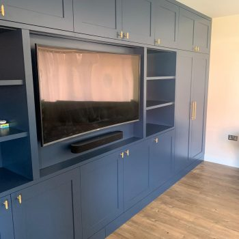 Media Wall Joinery finished sprayed in colour Farrow and Ball Stiffkey Blue