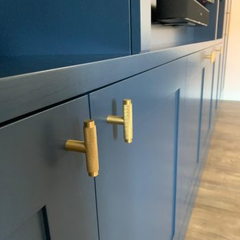 Close up picture of Dark Blue media wall unit showing of the beautiful Brass handles